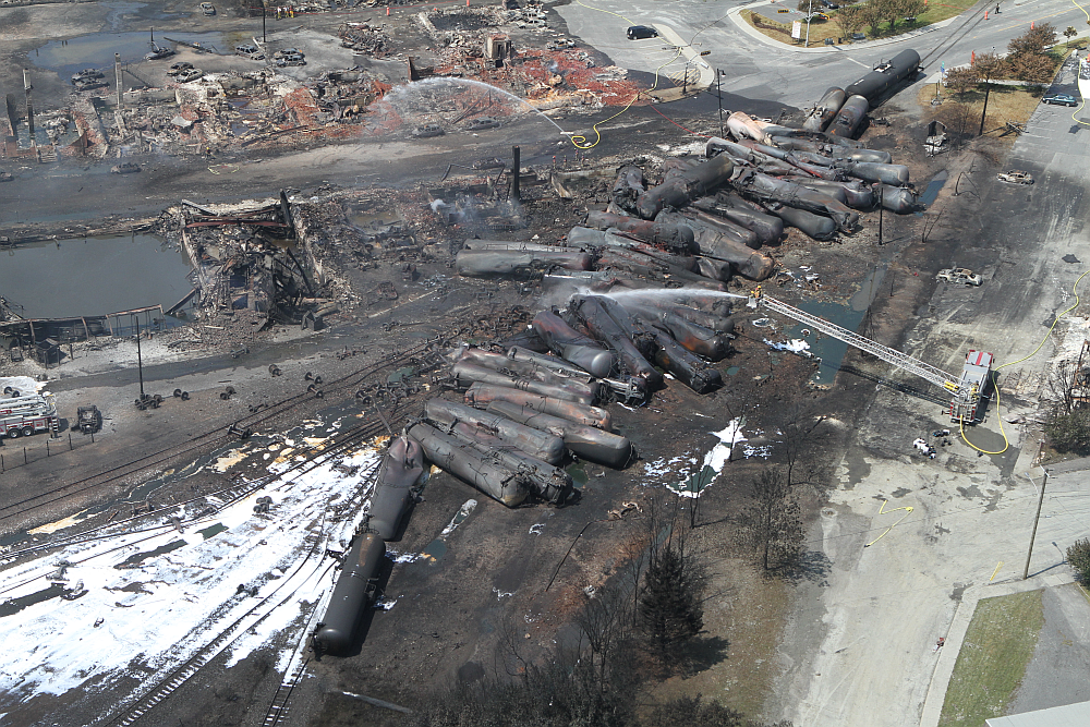 Aerial view of charred freight train in Lac-Megantic