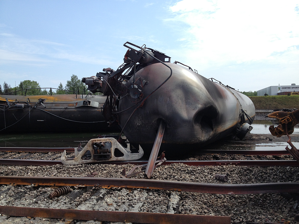 Overturned tank cars and twisted rails at Lac-Mégantic accident site