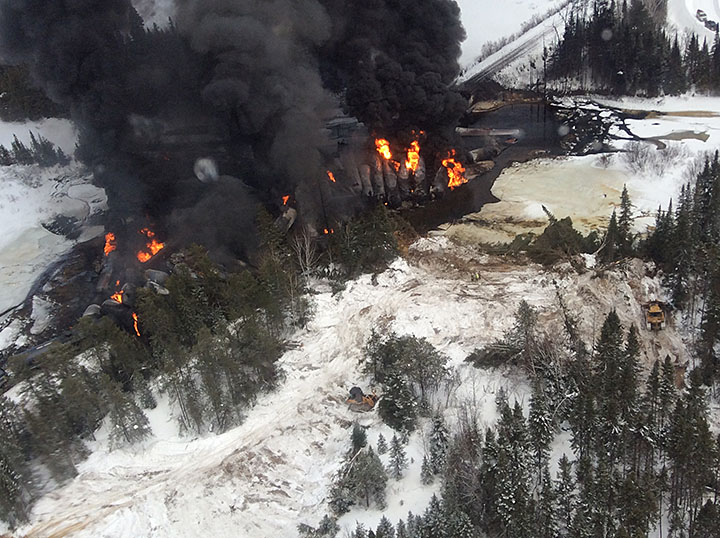 Aerial eastward view of derailment site, with a few submerged tank cars (March 7, 2015)
