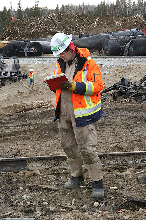 Image of a TSB investigator assessing the accident site