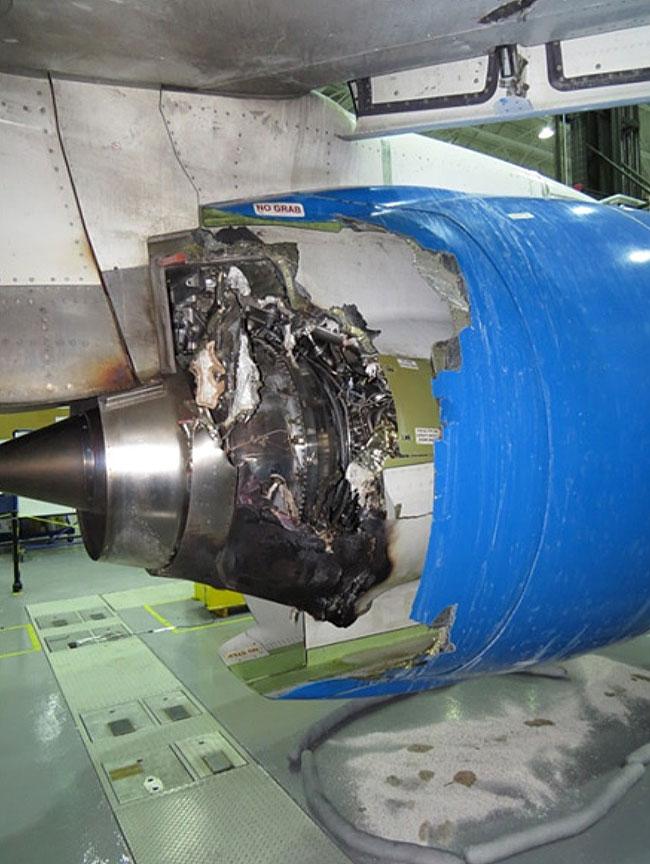 Image of hte left inboard thrust reverser cowl damage